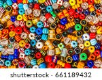 Colorful Beads On A Wooden...