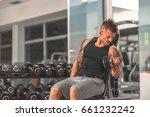 handsome muscular man exercise... | Shutterstock . vector #661232242