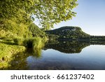 scenic reflection of forest in... | Shutterstock . vector #661237402