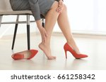 young woman suffering from leg... | Shutterstock . vector #661258342