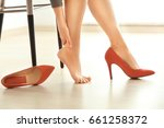 young woman suffering from leg... | Shutterstock . vector #661258372
