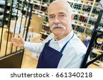 smiling seller man wearing... | Shutterstock . vector #661340218