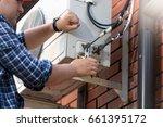 male technician repairing... | Shutterstock . vector #661395172