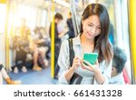 woman working on mobile phone... | Shutterstock . vector #661431328