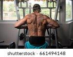 handsome athlete doing heavy... | Shutterstock . vector #661494148