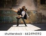 young man lifting her dancing... | Shutterstock . vector #661494592