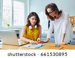two women working together at...   Shutterstock . vector #661530895