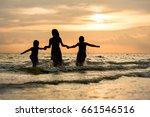 happy family run on beach... | Shutterstock . vector #661546516