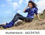 Stock photo beautiful smiling stylish girl on sky background 66154765