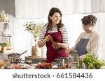 granddaughter cooking dinner... | Shutterstock . vector #661584436
