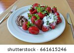 strawberry with chocolate on a... | Shutterstock . vector #661615246