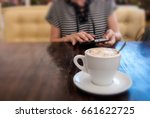 white cup with coffee. on a... | Shutterstock . vector #661622725