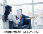 young woman sitting indoors  in ... | Shutterstock . vector #661693642