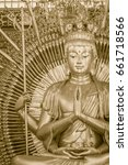 """Small photo of Golden statue of Guan Yin with 1000 hands. Guanyin or Guan Yin is an East Asian bodhisattva associated with compassion as venerated by Mahayana Buddhists and known as the """"Goddess of Mercy"""" in English"""