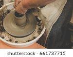 woman's hands making ceramic... | Shutterstock . vector #661737715