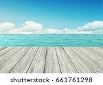 wooden table  wooden floor by... | Shutterstock . vector #661761298