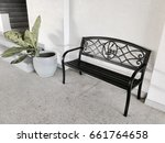 black bench and flower pot in... | Shutterstock . vector #661764658