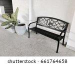black bench and flower pot in... | Shutterstock . vector #661764658