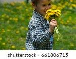 a little boy is carrying a... | Shutterstock . vector #661806715