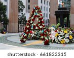 Small photo of BRISBANE, AUSTRALIA - APRIL 25, 2017: Flowers laid at the ANZAC Memorial as the eternal flame burns.