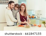 happy family preparing... | Shutterstock . vector #661847155