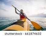 kayaking. kayak paddling.... | Shutterstock . vector #661874632