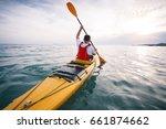 Kayaking. Rear View Of Man...