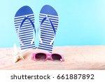 blue flip flops with sunglasses ... | Shutterstock . vector #661887892