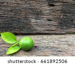 green lime on a old wood as a... | Shutterstock . vector #661892506
