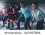 group of young athletes working ... | Shutterstock . vector #661907806