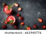Small photo of Strawberry smoothie in glass on dark background with copy space. Summer drink cocktail. Healthy eating dieting and breakfast concept. Top view