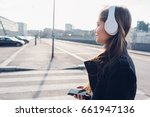side view young woman walking... | Shutterstock . vector #661947136