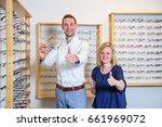 in optician shop  young woman... | Shutterstock . vector #661969072