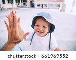 cute boy son giving high five... | Shutterstock . vector #661969552
