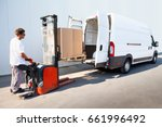 courier is loading the van with ... | Shutterstock . vector #661996492
