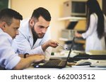 two young scientists look at... | Shutterstock . vector #662003512