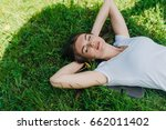 beautiful young woman laying on ... | Shutterstock . vector #662011402