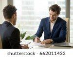 smiling businessman signing... | Shutterstock . vector #662011432
