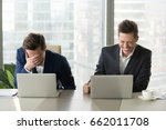 two businessmen laughing out... | Shutterstock . vector #662011708