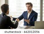businessmen arguing at... | Shutterstock . vector #662012056