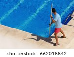 a guy cleaning the swimming... | Shutterstock . vector #662018842
