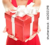 Christmas. Gift woman showing beautiful red gift box - closeup of present on white background. - stock photo