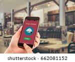 online food order concept.hands ... | Shutterstock . vector #662081152