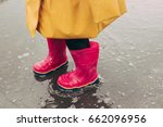 kid in pink rubber boots make... | Shutterstock . vector #662096956
