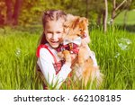 the small girl with pomeranian... | Shutterstock . vector #662108185