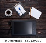 graphik tablet on wood table.... | Shutterstock . vector #662129332
