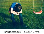 sad lonely boy sitting on swing ... | Shutterstock . vector #662142796