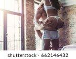passionate couple in bedroom is ... | Shutterstock . vector #662146432