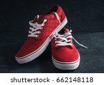 pair of stylish red sneakers on ... | Shutterstock . vector #662148118