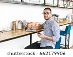 happy man working on laptop and ... | Shutterstock . vector #662179906